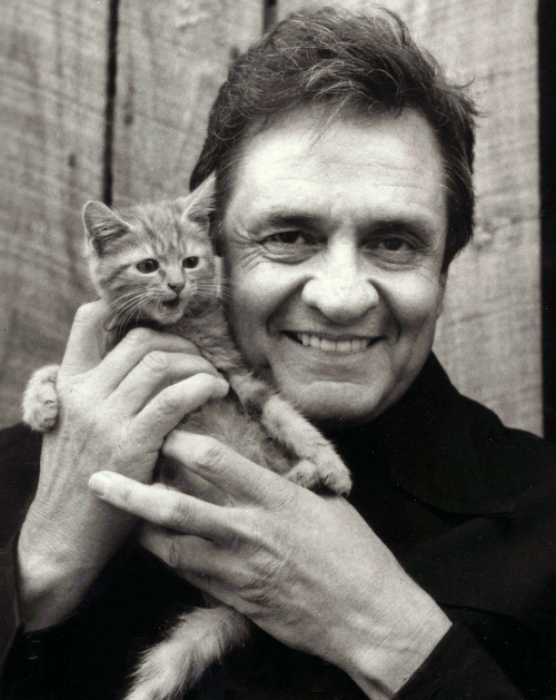 Johnny Cash holding a kitteh.
